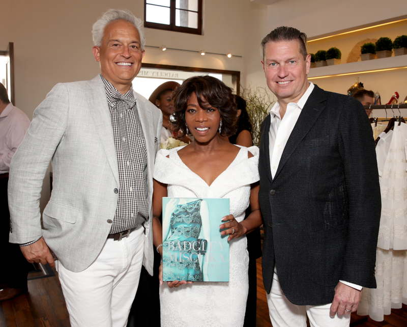 "Actress Alfre Woodard with hosts/designers Mark Badgley (L) and James Mischka (R) during the Badgley Mischka book signing to celebrate ""Badgley Mischka: American Glamour"""