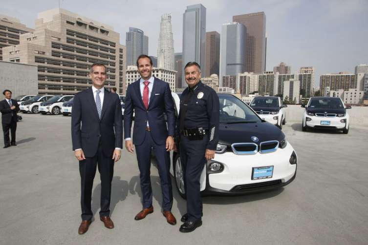 Mayor Eric Garcetti, Petter Witt, Executive Vice President of Operations, BMW North America and LAPD Chief of Police Charlie Beck pose among the Los Angeles Police Department's newly unveiled transportation fleet of 100 all-electric BMW i3 vehicles
