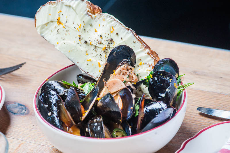 Cockscomb's drunken mussels with Negroni broth.
