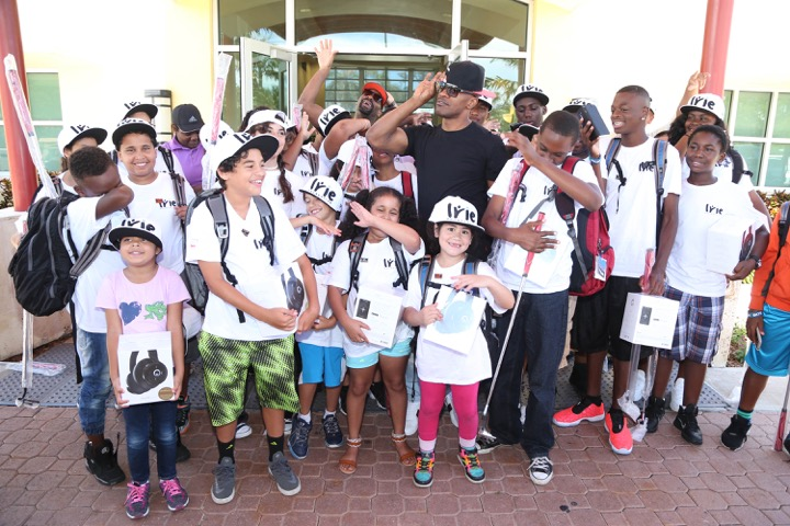 DJ Irie & Jamie Foxx having fun with the kids at #InspIRIE kids golf clinic during the 12th Annual IRIE Weekend