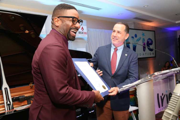 Mayor Phillip Levine presenting DJ IRIE with a proclamation at the #InspIRIE Gala dinner