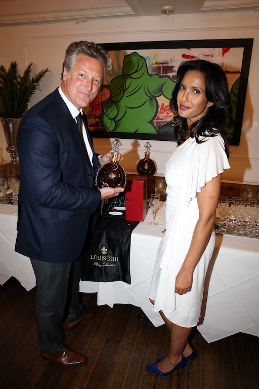 NEW YORK, NY - JULY 06: (L-R) Vice President Louis XIII Americas Yves De Launay and Padma Lakshmi attend the Rolls-Royce, Louis XIII, And JetSmarter Celebration of the Padma Lakshmi Haute Living Cover at Bagatelle on July 6, 2016 in New York City. (Photo by Johnny Nunez/Getty Images for Haute Living)