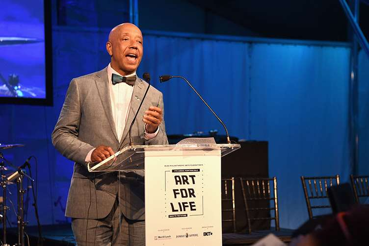 CEO of Rush Communications Russell Simmons speaks onstage during Rush Philanthropic Arts Foundation's 2016 ART FOR LIFE Benefit at Fairview Farms on July 16, 2016 in Bridgehampton, New York. (Photo by Nicholas Hunt/Getty Images for Rush Philanthropic Arts Foundation)
