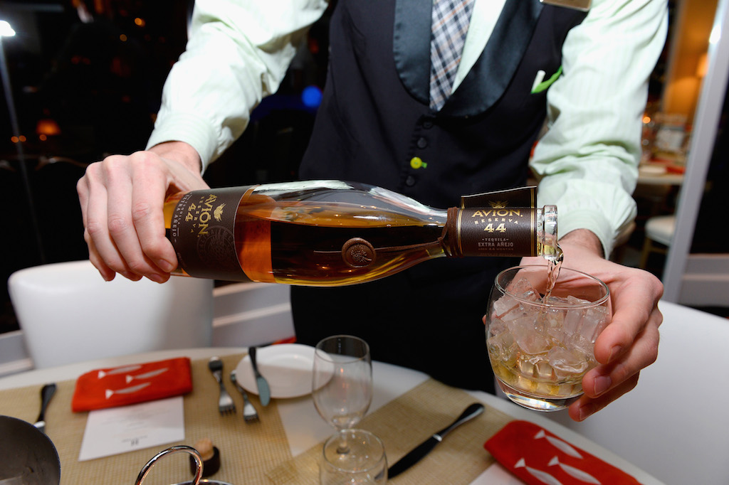 A bottle of Avion Reserva 44 is poured during the Team USA welcome dinner hosted by Carmelo Anthony at Lakeside at Wynn Las Vegas on July 17, 2016 in Las Vegas, Nevada. (Photo by Bryan Steffy/Getty Images)