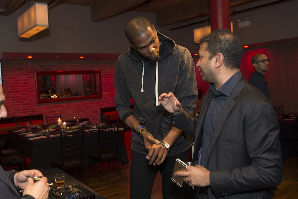 Kevin Durant and Kamal Hotchandani admiring the Hublot timepieces