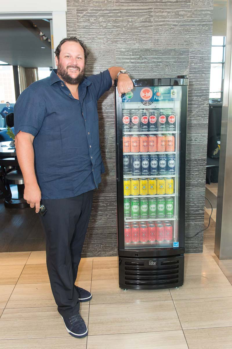 Todd Berardi poses with his new line of sparkling water.