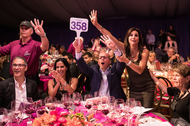 Guests bid at the live auction gala