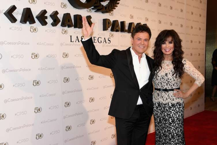 Donnie and Marie Osmond walk the red carpet at Caesars Palace.