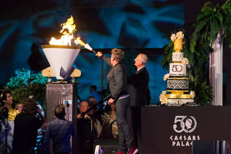 Gordon Ramsay lights the celebratory cauldron at Caesars Palace.