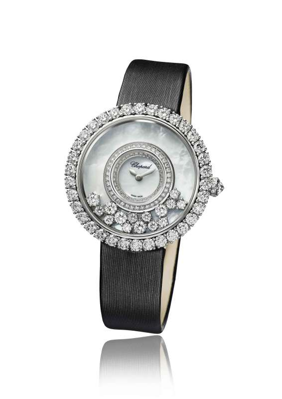 The 40th anniversary watch in 18-karat white gold with prong-set diamond bezel and 15 prong-set free-floating diamonds