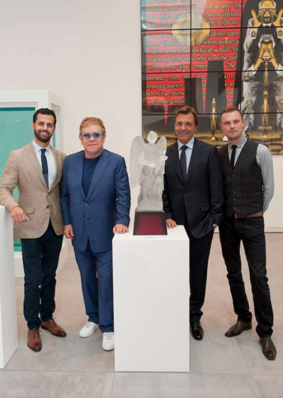Maz Zouhairi with Elton John (both at left). Lalique collaborated with the singer for a special crystal collection that benefited the Elton John AIDS Foundation. with Elton John (both at left). Lalique collaborated with the singer for a special crystal collection that benefited the Elton John AIDS Foundation.