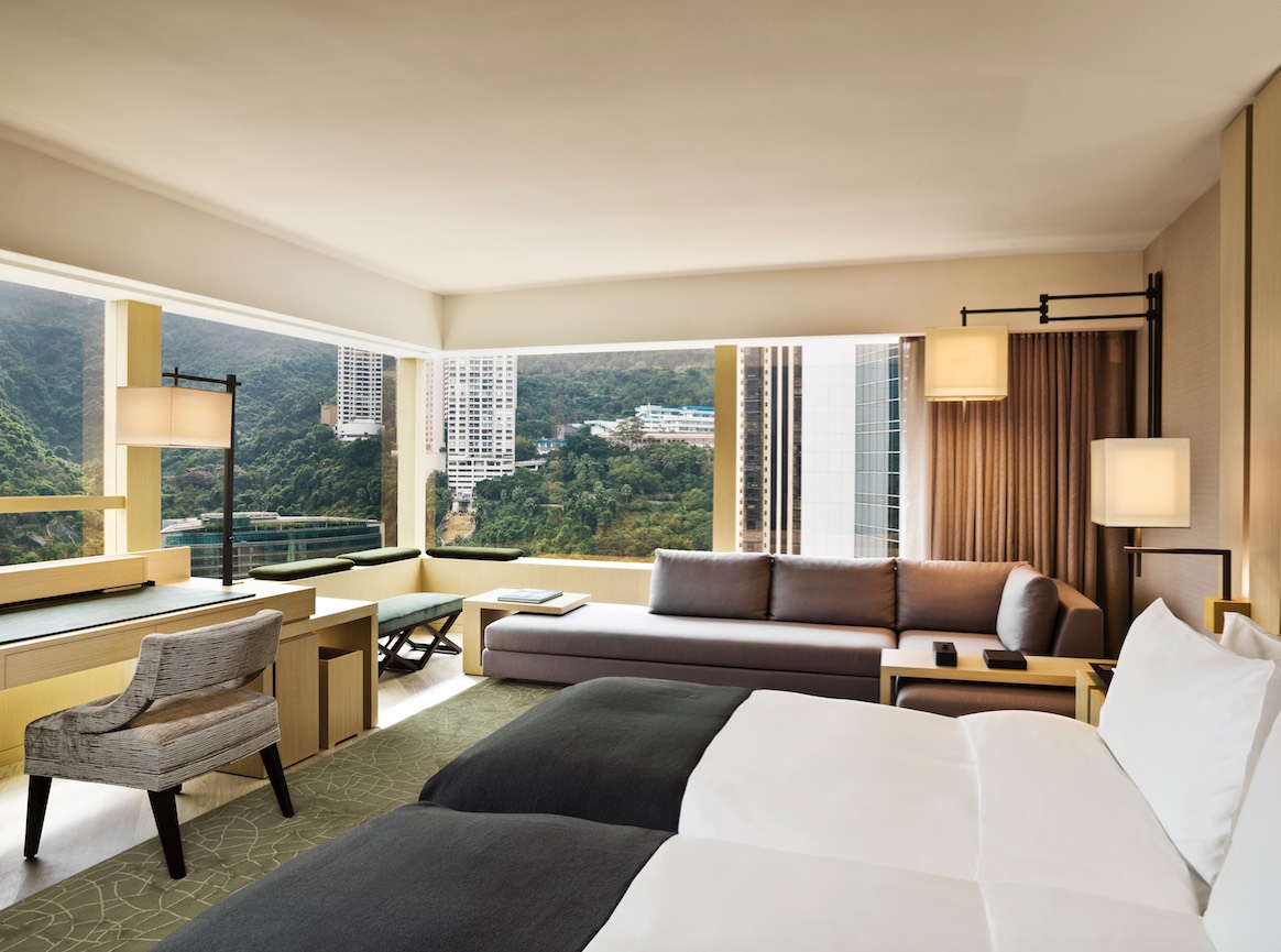 Swire's Upper House Room offers views of verdant mountains and Victoria Harbour
