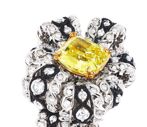 "The collection's ""Salon de Vénus Diamant Jaune"" ring with a yellow diamond and white diamonds in white gold and darkened silver"