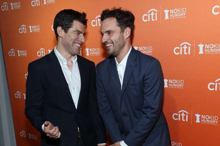Max Greenfield and Jake Johnson share a moment at the annual No Kid Hungry dinner
