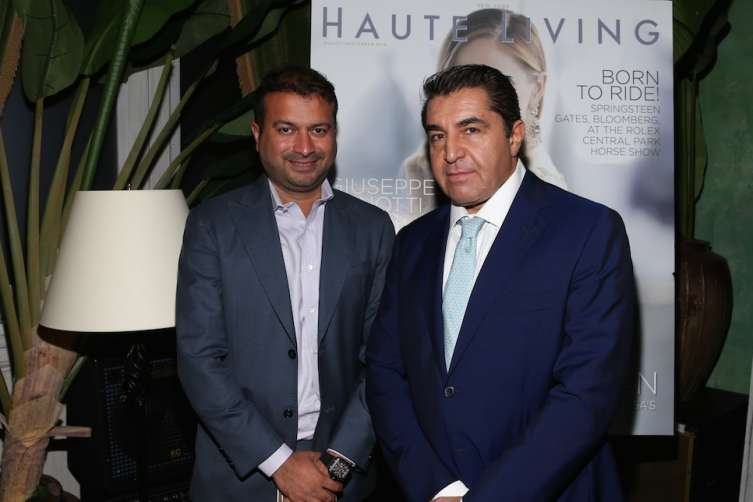NEW YORK, NY - SEPTEMBER 27: Haute Living's CEO and Publisher Kamal Hotchandani (L) and Paolo Zampolli attend the Haute Living Celebrates Georgina Chapman with Perrier-Jouet and JetSmarter event at Socialista New York on September 27, 2016 in New York City. (Photo by Rob Kim/Getty Images for Haute Living)
