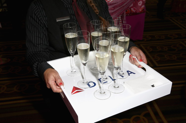 "Champagne glasses on display during the ""Breast Cancer One"" dinner hosted by Delta Air Lines"