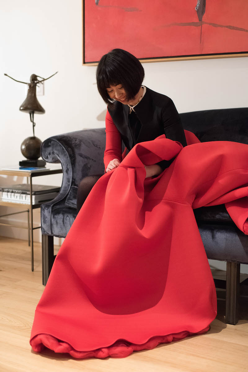 Uehara hand sews one of her gowns