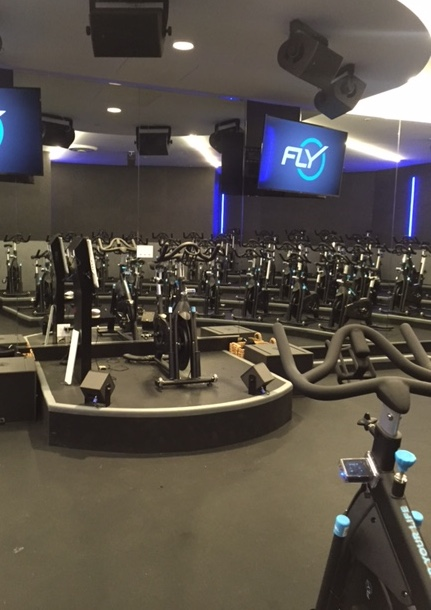 The stadium like set up inside Flywheel's cycling studio