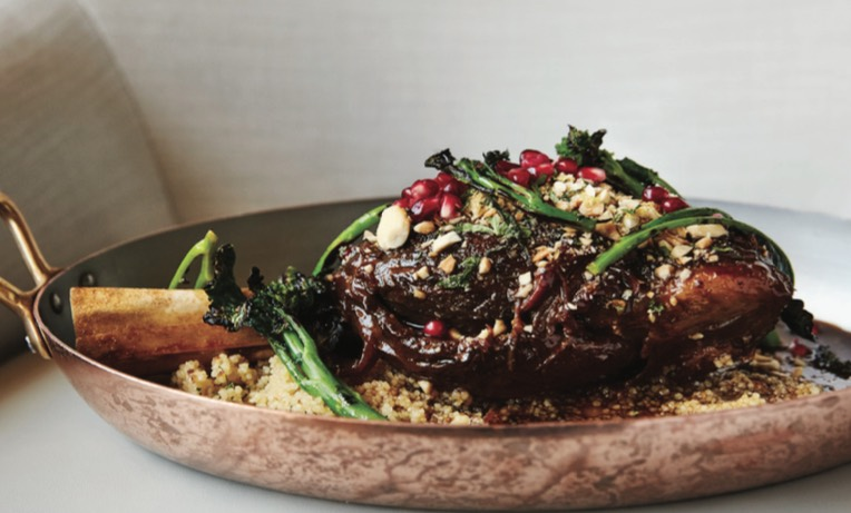 The succulent Moroccan Spiced Lamb Shank is served with cous cous, Meyer lemon and broccolini.