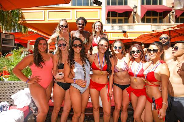 The U.S. Olympic Women's Water Polo Team celebrates their gold medals at Tao Beach.