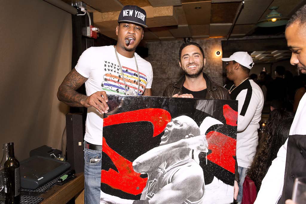 Carmelo Anthony with painting