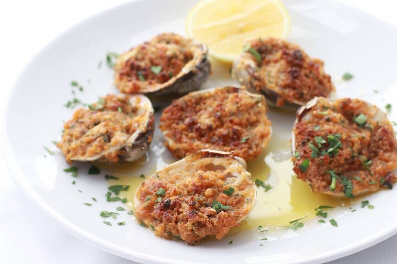 Baked clams oreganata from the Little Italy concept