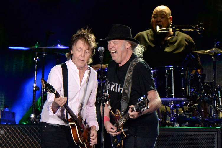 Neil Young (R) performs with Sir Paul McCartney onstage during Desert Trip at The Empire Polo Club on October 8