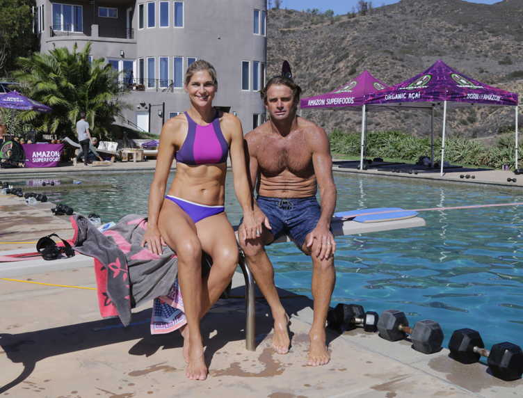 How to look like a warrior: Reece with pro surfer husband Laird Hamilton at the Sambazon event in Malibu