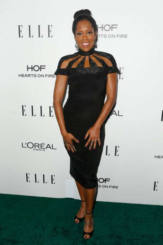 Regina King is wearing a Regina is wearing a Christian Siriano dress.
