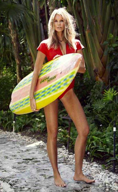 Elle Macpherson surfing