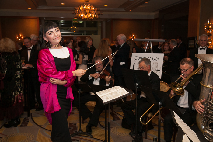 Superstar Singer from ZUMIX Angelina Botticelli conducting the Boston Landmarks Orchestra at the 15th Anniversary Gala, Saturday, October 1, 2016, at the Mandarin Oriental, Boston, MA