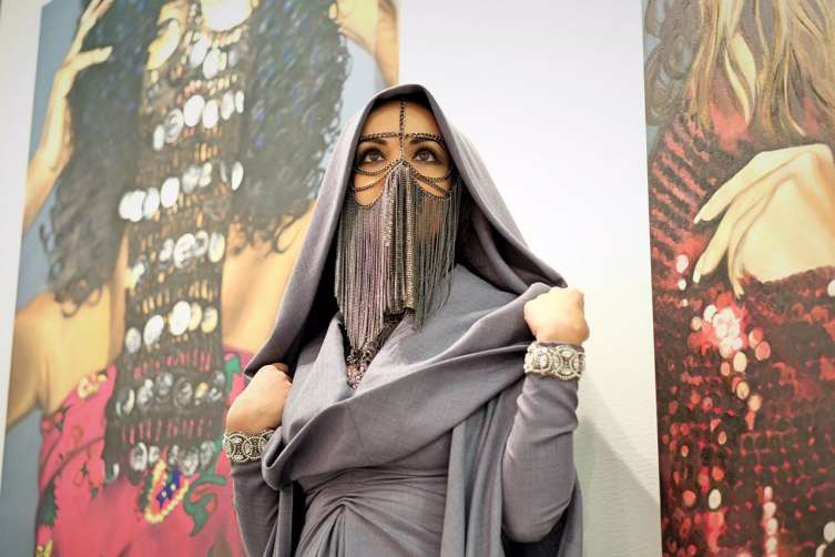 New York Show - Mashael next to her paintings