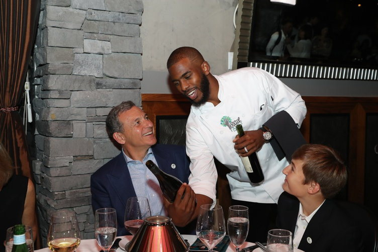 Chris Paul serves Bob Iger
