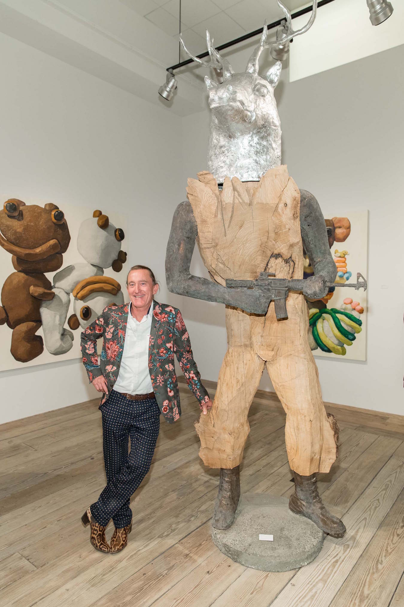 Harry Siter poses with his sculpture