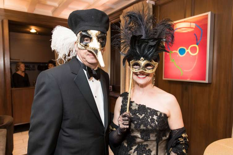 Masked revelers at the ball
