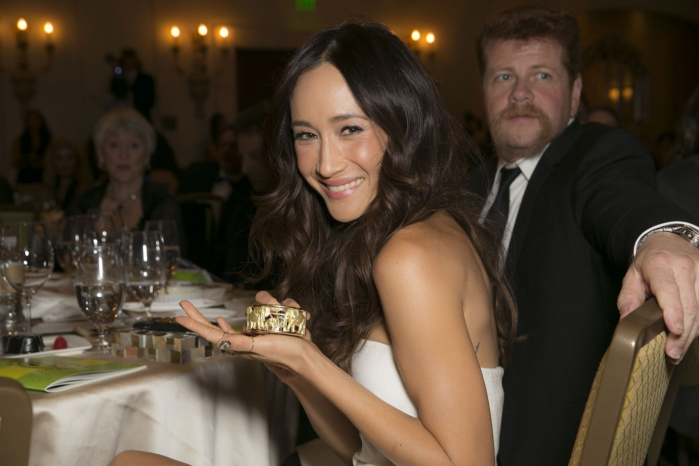 Actress Maggie Q shows off a animal-inspired bracelet at the 2015 WildAid Gala