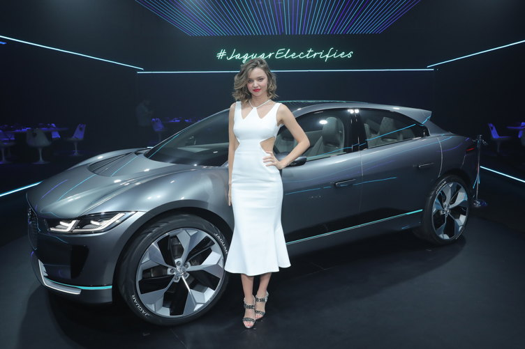Supermodel Miranda Kerr poses with the Jaguar I-PACE Concept, an all-electric performance vehicle, ahead of its global debut at the Los Angeles Auto Show with an exclusive VIP reception at Milk Studios