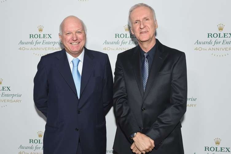 Chairman of the board of Rolex Bertrand Gros (L) and filmmaker James Cameron attend the 2016 Rolex Awards for Enterprise at the Dolby Theatre