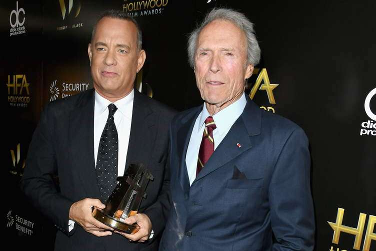 "Tom Hanks, recipient of the ""Hollywood Actor Award"" for ""Sully"" (L) and presenter Clint Eastwood"
