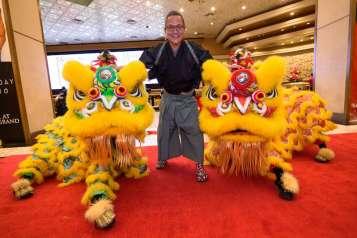 Chef Masaharu Morimoto with lion dancers