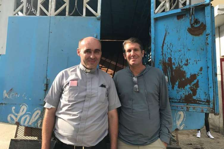 Michael Capponi with Father David Fontaine in Haiti