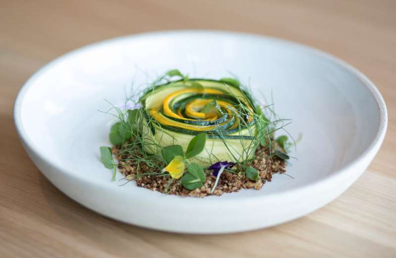 Chef Vartan Abgar- yan plates up delec- table dishes such as summer squash with basil, garlic, pine nuts, pumpernickel, sumac and grana
