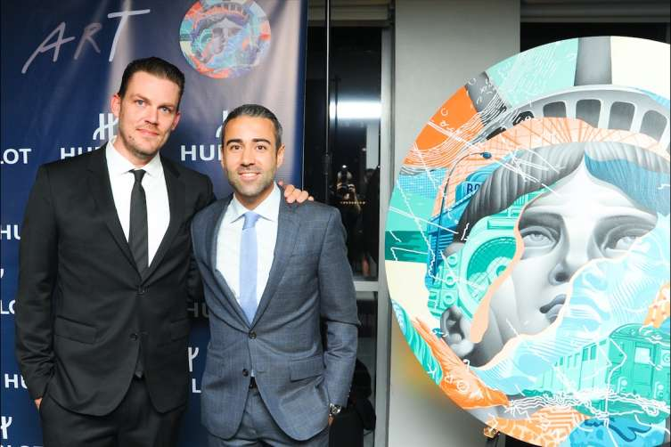 Street Artist, Tristan Eaton and Managing Director of Hublot of America, Jean-Francois Sberro at the unveiling of Hublot Classic Fusion Aerofusion Concrete Jungle timepiece