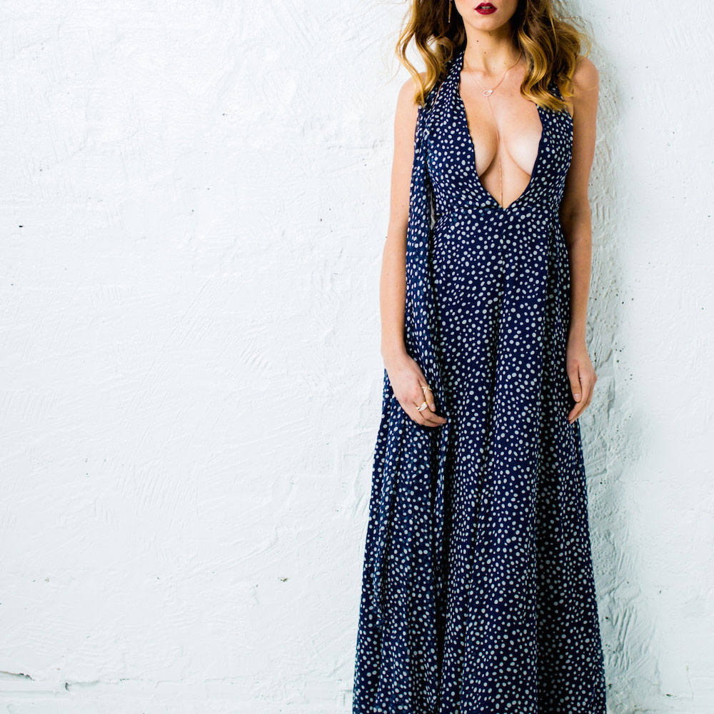 Modern woman ivory + navy polka dot sheer silk layered jumpsuit from Jake's current collection