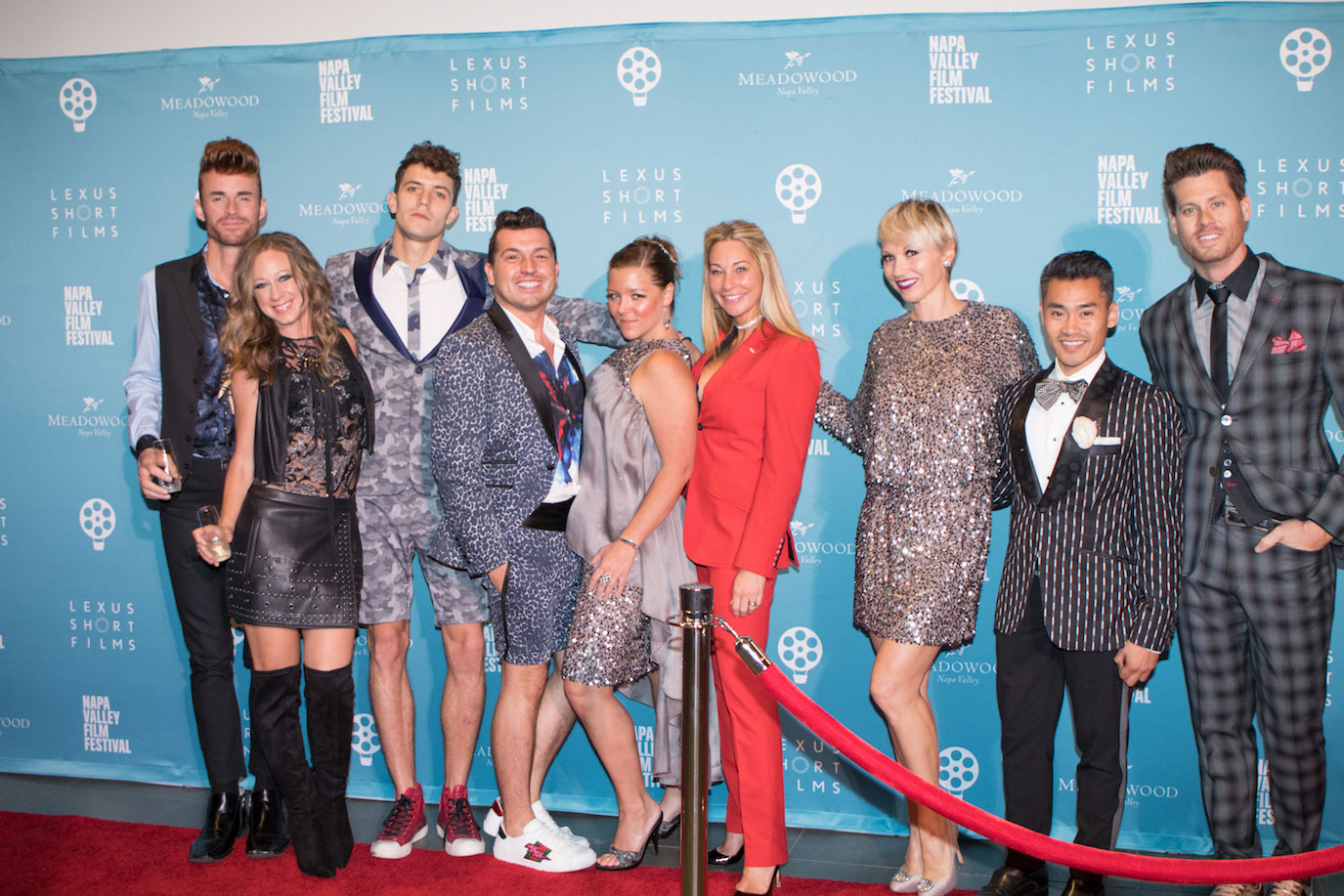 The Jake posse includes Penelope Moore, second from left, model Robert Mull, and Jake Wall; Tiffany Cummins in red pantsuit, and Nathan Johnson far right