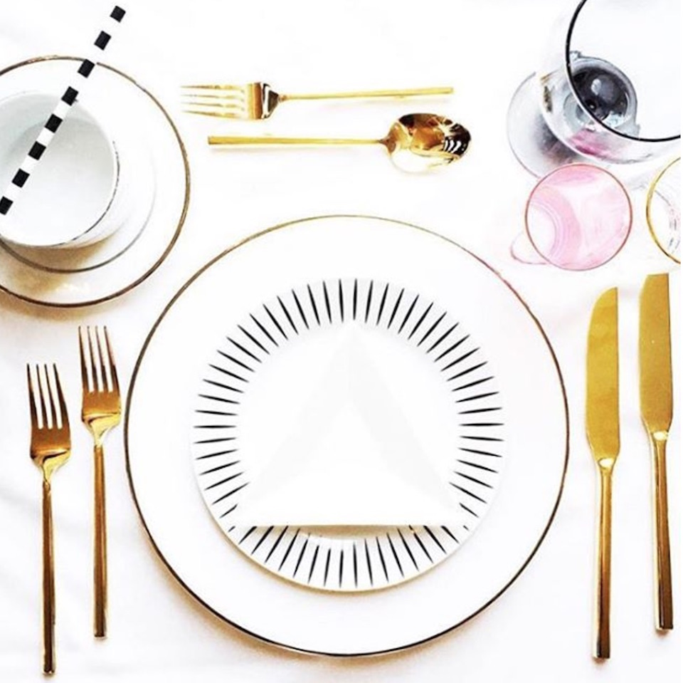 Curtis designed all of the linens, plates, and silverware