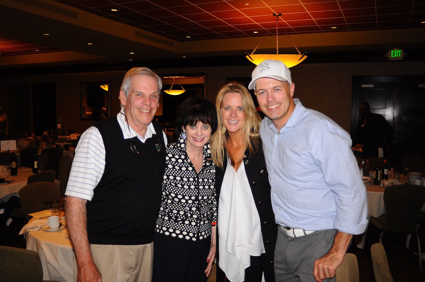 Newsom smiles with her in-laws, Robert and Barbara Callan, and her husband, Geoff Callan.
