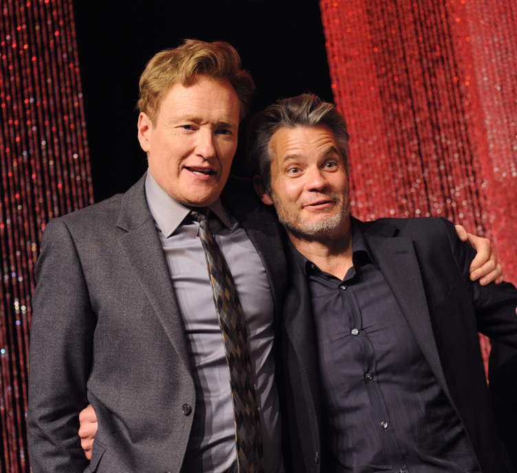 Host Conan O'Brien (L) and actor Timothy Olyphant