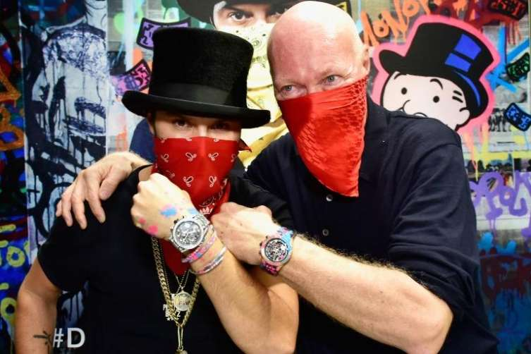 Alec Monopoly (left) with TAG Heuer CEO Jean-Claude Biver on the occasion of Alex Monopoly's appointment as the brand's Art Provocateur.