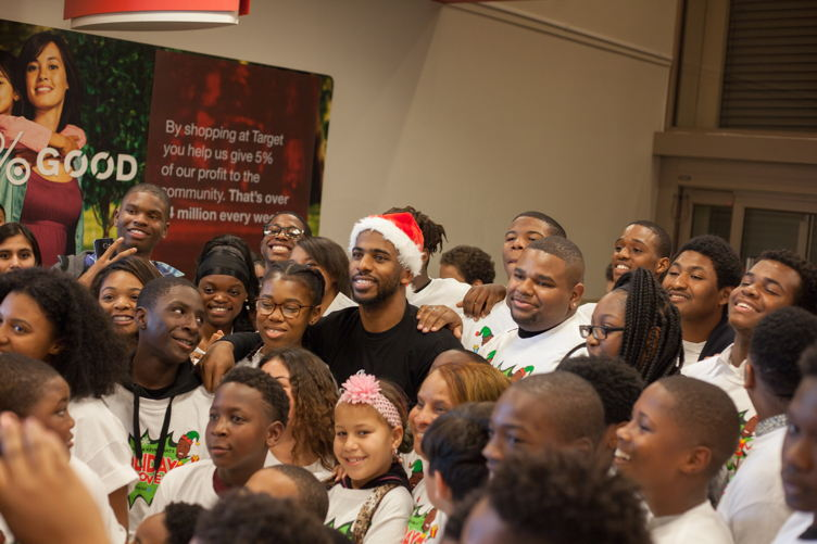 Chris Paul dons a Santa hat while helping kids shop at the 3rd Annual Holiday Takeover